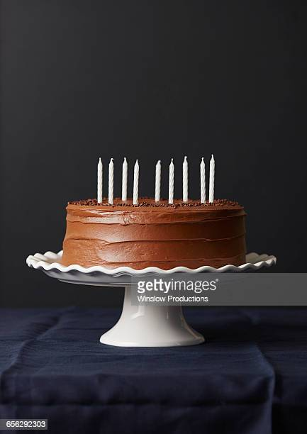 studio shot of chocolate birthday cake - birthday cake stock photos and pictures