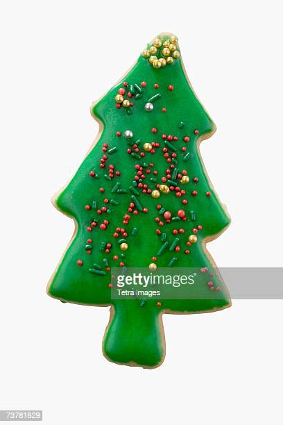 studio shot of christmas tree cookie - novelty item stock pictures, royalty-free photos & images