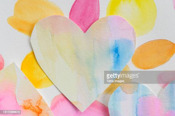 studio shot of colorful paper heart - montclair stock pictures, royalty-free photos & images