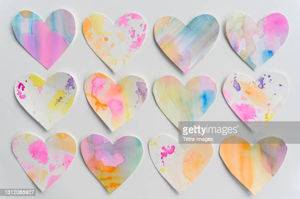 studio shot of colorful paper hearts - montclair stock pictures, royalty-free photos & images