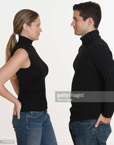 Studio shot of couple with hands in back pockets