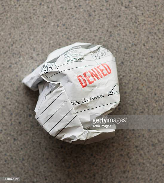 studio shot of crumpled document - dismissal stock photos and pictures