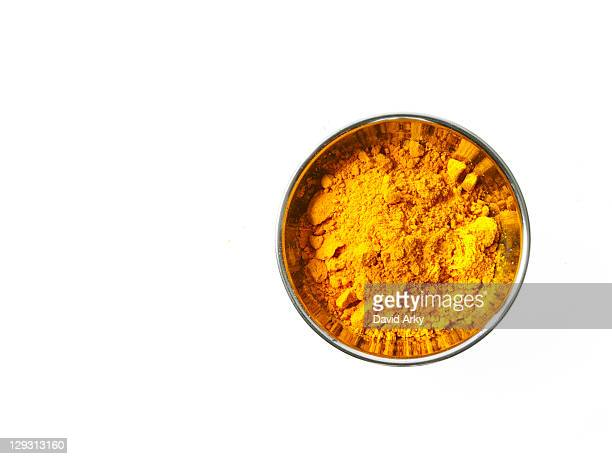 studio shot of curry powder in pan on white background - curry stock pictures, royalty-free photos & images