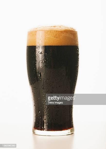 Studio shot of dark beer in glass