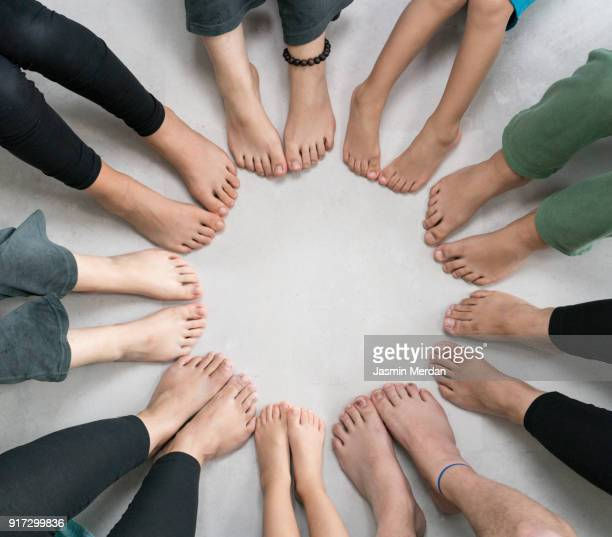 studio shot of feet in circle - barefoot stock pictures, royalty-free photos & images