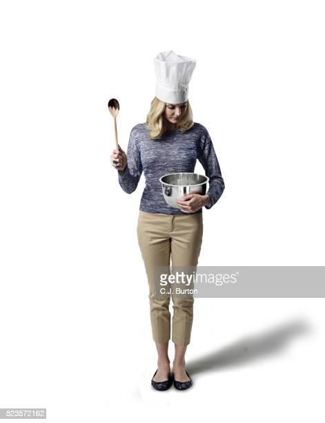 Studio shot of female chef, white background