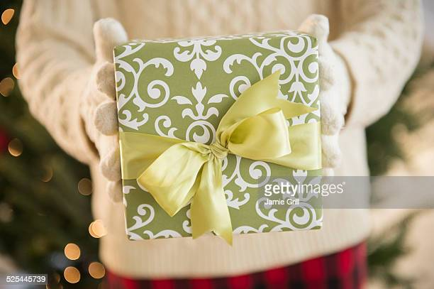 Studio Shot of female's hands holding gift