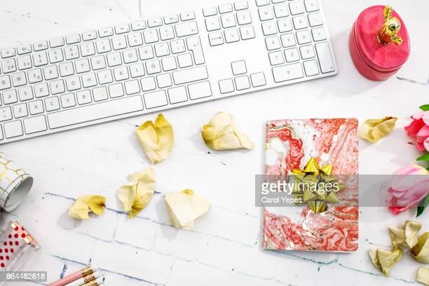 Studio shot of  feminine pink Computer Keyboard and gift