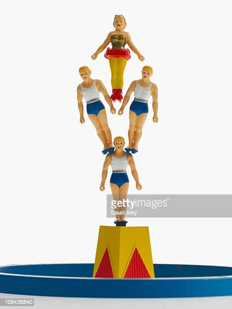 Studio shot of figurines of acrobats