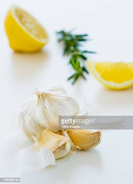 Studio shot of fresh garlic lemon and rosemary