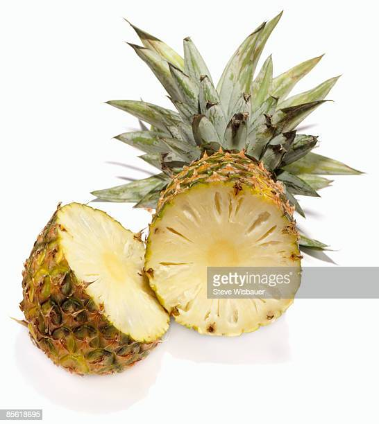 Studio shot of fresh pineapple fruit cut in half