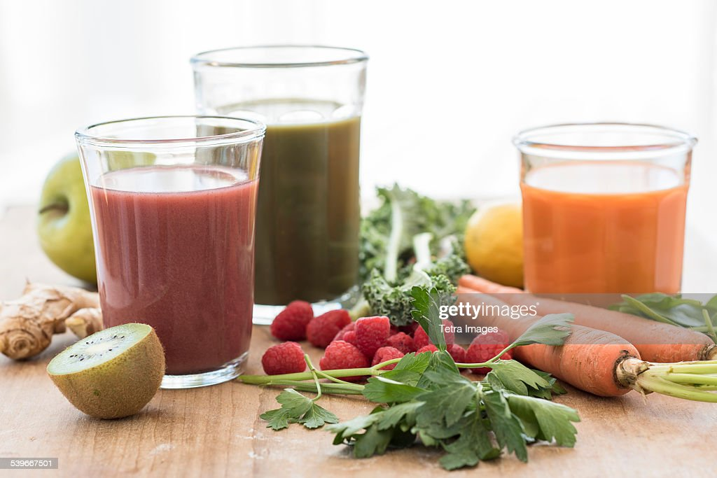 Studio shot of fruit and vegetable juices : Stock Photo
