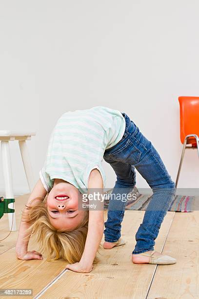 Studio shot of girl bending backwards doing the crab