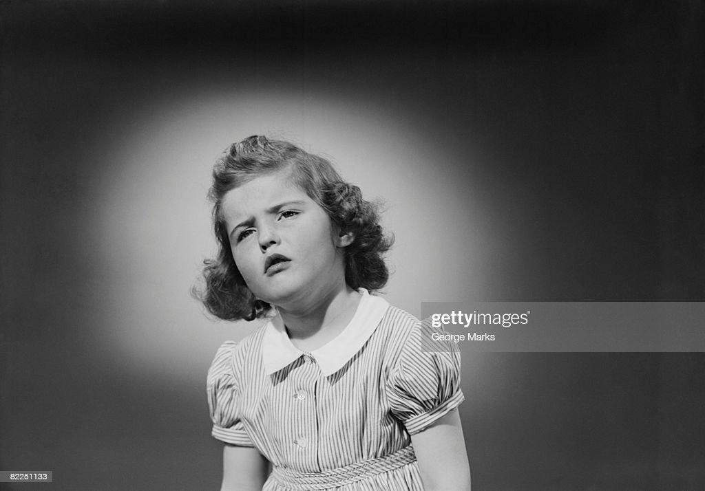 Studio shot of girl (6-7) grimacing : Stock Photo