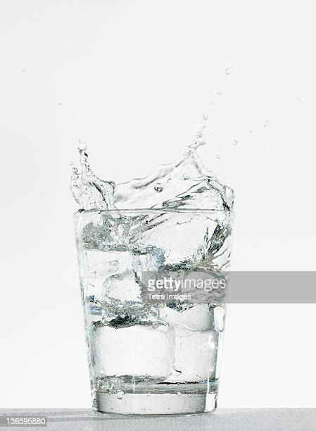 studio shot of glass of water with splash - glass of water stock pictures, royalty-free photos & images