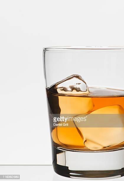 Studio shot of glass of whiskey