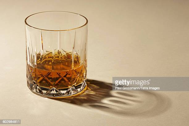 studio shot of glass with alcohol - whisky stock photos and pictures