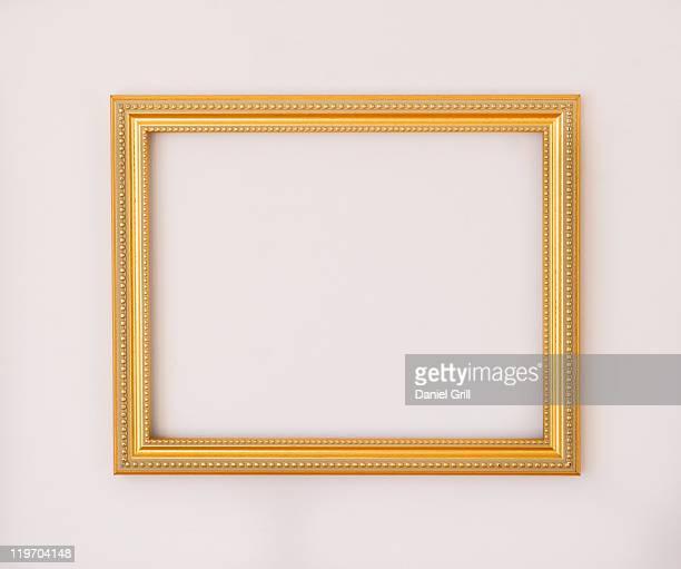 Studio shot of golden picture frame on white background