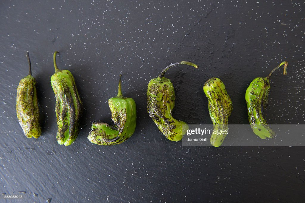 Studio shot of grilled shishito peppers : Stock Photo