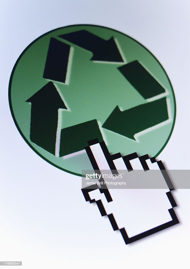 Studio shot of hand cursor on recycling icon : Stock Photo