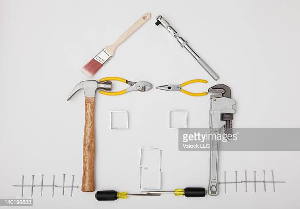 Studio shot of hand tools in house shape