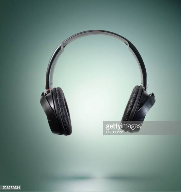 studio shot of headphones, turquoise background - headphones stock pictures, royalty-free photos & images