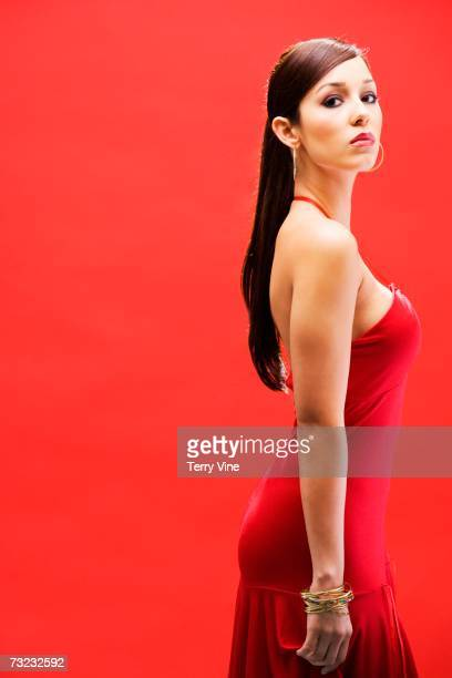 Studio shot of Hispanic woman in evening gown