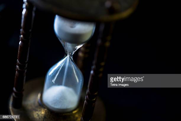 studio shot of hourglass - time travel stock pictures, royalty-free photos & images