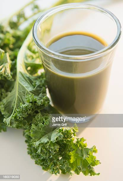 Studio shot of kale and green smoothie