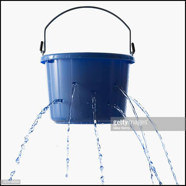 Studio shot of leaking bucket