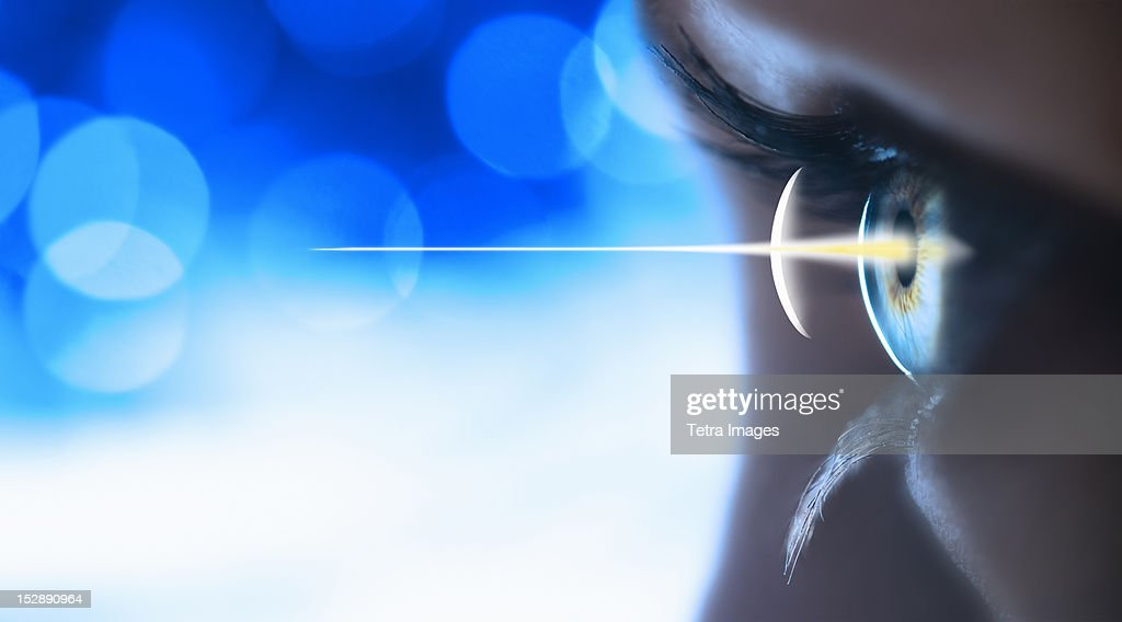Studio shot of light beam coming from eye : Stock Photo