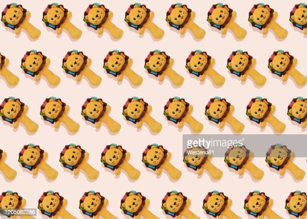 studio shot of lion-shaped rattle toys - undomesticated cat stock pictures, royalty-free photos & images