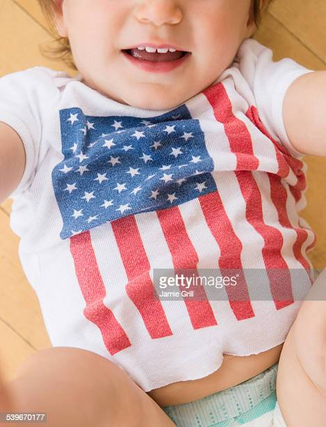 studio shot of little girl (18-23 months) in t-shirt with american flag - 18 23 months stock pictures, royalty-free photos & images