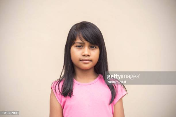 studio shot of little girl with pink shirt - one girl only stock pictures, royalty-free photos & images