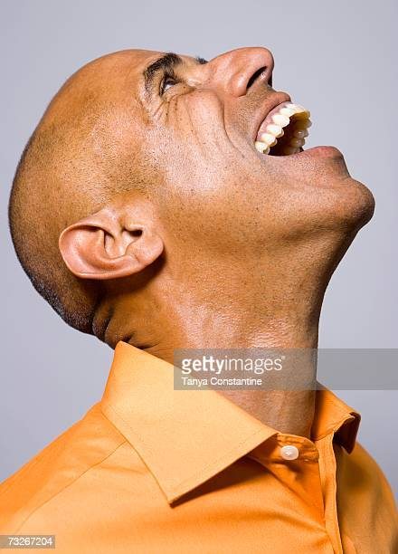 Studio shot of man laughing and looking up