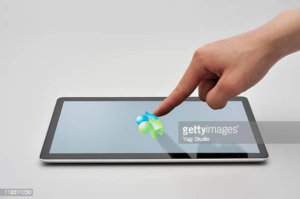 Studio shot of man with digital tablet