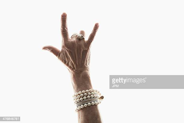 Studio shot of mature woman's hand making gesture
