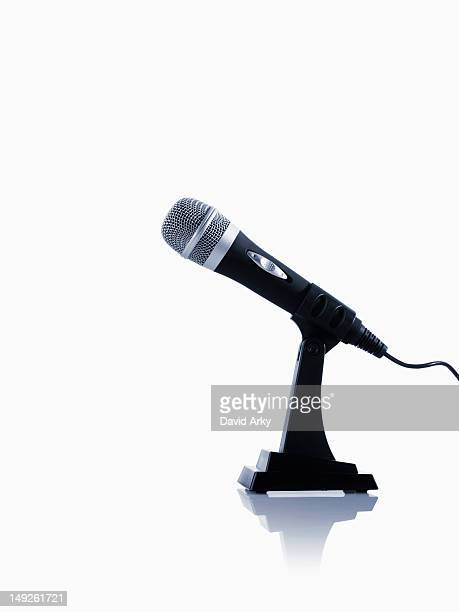 studio shot of microphone on white background - microphone stand stock photos and pictures