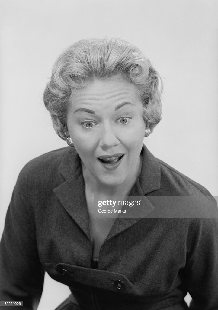 Studio shot of mid adult woman with facial expression : Stock Photo