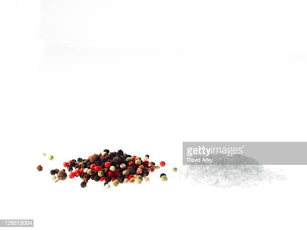 Studio shot of mixed pepper corns and coarse salt