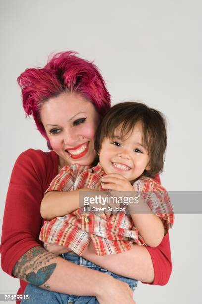 Studio shot of mother hugging young son