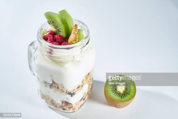 studio shot of muesli with yogurt, kiwi and raspberry, australia - image stock pictures, royalty-free photos & images