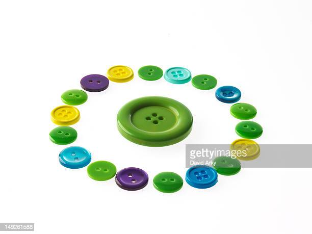 Studio shot of multi colored buttons arranged in circle