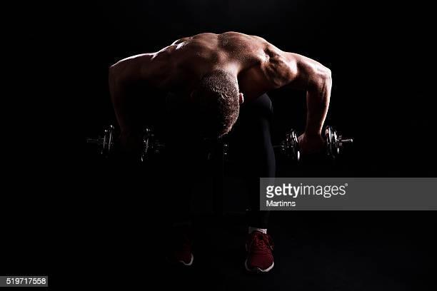 studio shot of muscular male bodybuilder