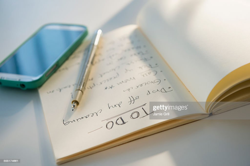 Studio shot of notebook with list of things to do : Stock Photo