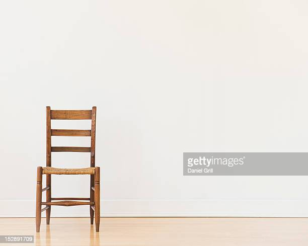 studio shot of old chair - chair stock pictures, royalty-free photos & images