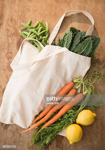 Studio shot of organic vegetables in shopping bag