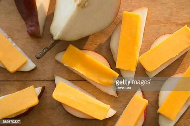 Studio shot of pear slices with cheddar cheese
