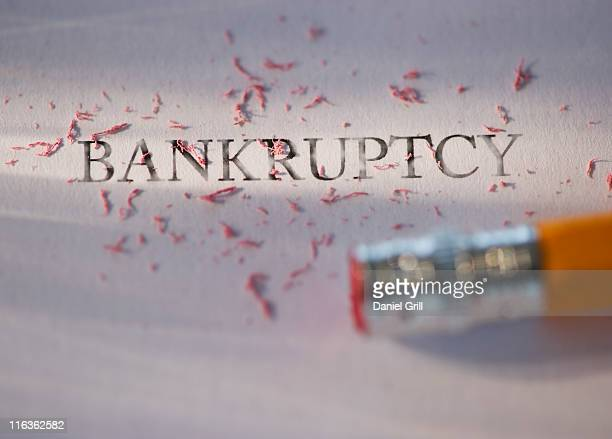 studio shot of pencil erasing the word bankruptcy from piece of paper - bankruptcy stock pictures, royalty-free photos & images