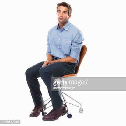 Studio Shot Of Pensive Business Man Sitting On Chair Stock ...